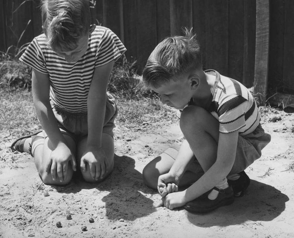 Two Boys Pitching Marbles