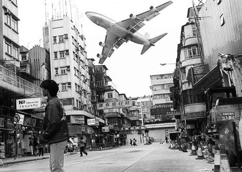 Aircraft landing at Kai Tak airport Hong Kong